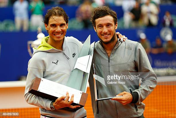 Rafael Nadal of Spain and Juan Monaco of Argentina pose for a photo after the singles final match between Rafael Nadal of Spain and Juan Monaco of...