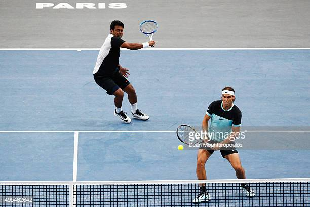 Rafael Nadal of Spain and Leander Paes of India compete against Dominic Inglot of Great Britain and Robert Lindstedt of Sweden during Day 2 of the...