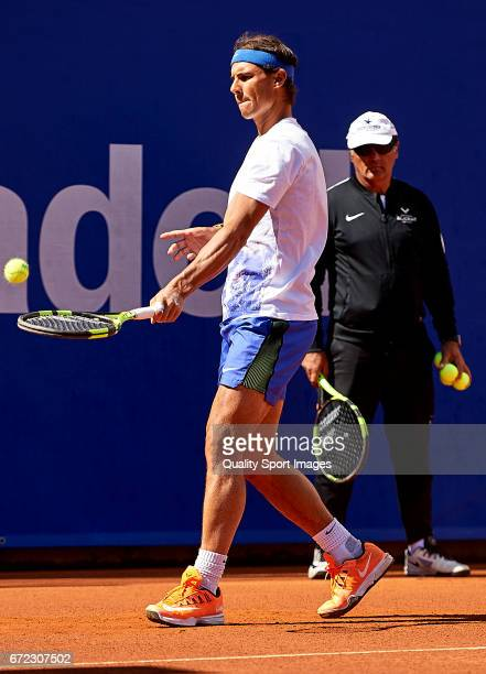 Rafael Nadal of Spain and manager Toni Nadal looks on as he trains during the Day 1 of the Barcelona Open Banc Sabadell at the Real Club de Tenis...