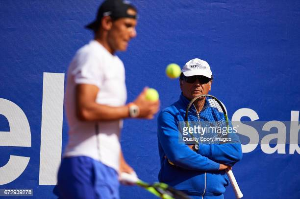 Rafael Nadal of Spain and manager Toni Nadal looks on as he trains during the Day 2 of the Barcelona Open Banc Sabadell at the Real Club de Tenis...