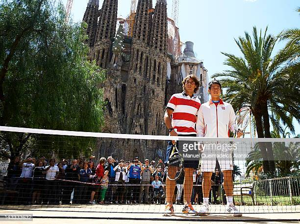 Rafael Nadal of Spain and Nishikori of Japan pose and play tennis in front of the Sagrada Familia to promote the ATP 500 World Tour Barcelona Open...