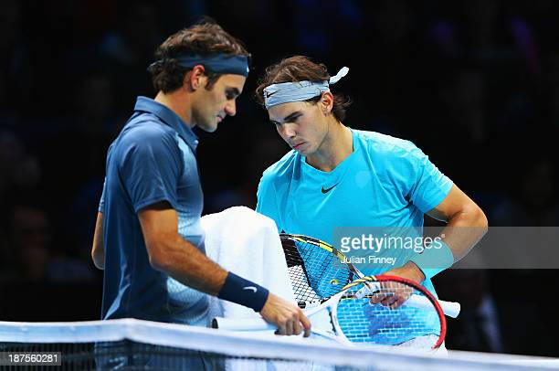 Rafael Nadal of Spain and Roger Federer of Switzerland changeover during their men's singles semifinal match on day seven of the Barclays ATP World...