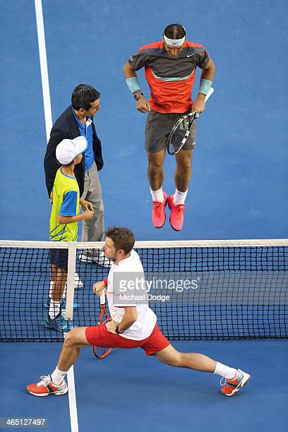 Rafael Nadal of Spain and Stanislas Wawrinka of Switzerland stretch ahead of their final match during day 14 of the 2014 Australian Open at Melbourne...