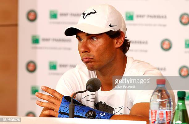 Rafael Nadal of Spain announces during a press conference that he is withdrawing from the tournament due to a wrist injury on day six of the 2016...