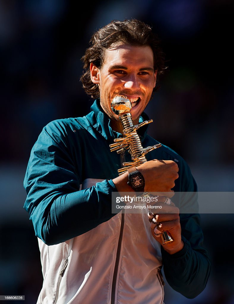 Rafael Nadal of Spain bites his trophy after winning his final match against Stanislas Wawrinka of Switzerland on day nine of the Mutua Madrid Open tennis tournament at the Caja Magica on May 12, 2013 in Madrid, Spain.