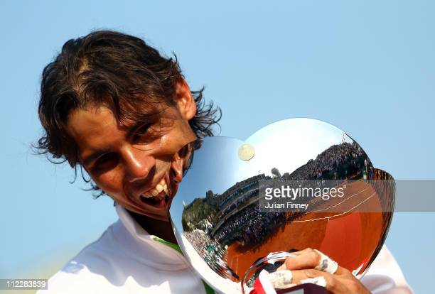 Rafael Nadal of Spain bites the trophy as he celebrates defeating David Ferrer of Spain in the final during Day Eight of the ATP Masters Series...
