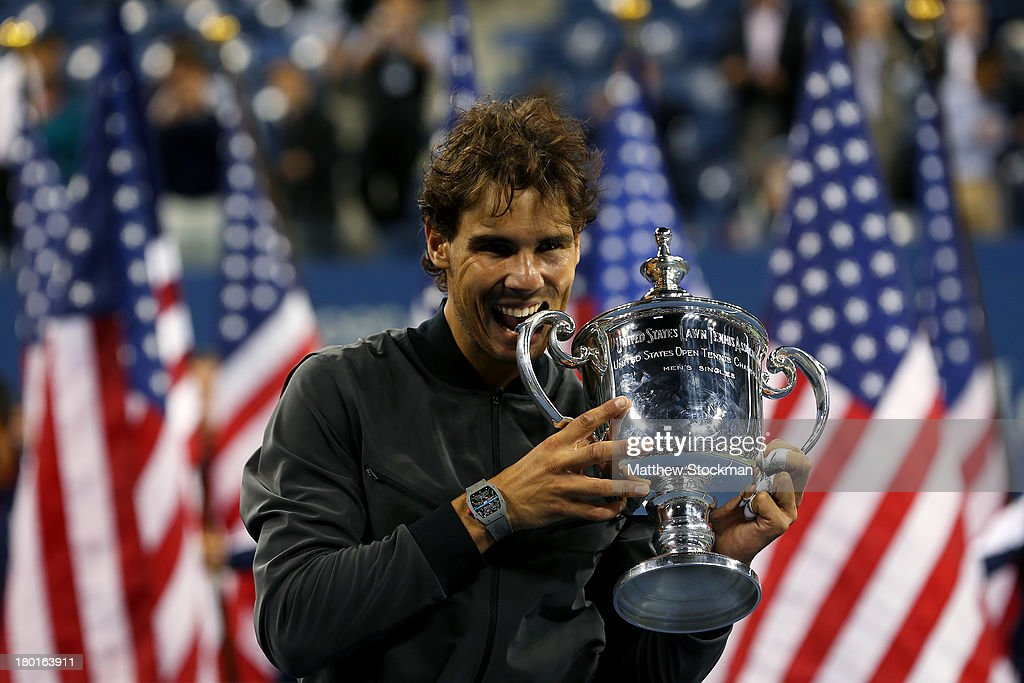 Rafael Nadal of Spain bites the trophy as he celebrates winning the men's singles final match against Novak Djokovic of Serbia on Day Fifteen of the 2013 US Open at the USTA Billie Jean King National Tennis Center on September 9, 2013 in the Flushing neighborhood of the Queens borough of New York City.