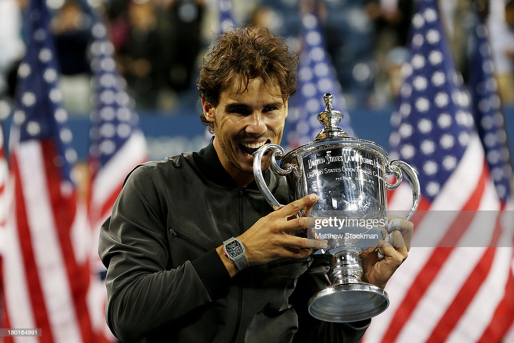 <a gi-track='captionPersonalityLinkClicked' href=/galleries/search?phrase=Rafael+Nadal&family=editorial&specificpeople=194996 ng-click='$event.stopPropagation()'>Rafael Nadal</a> of Spain bites the US Open Championship trophy as he celebrates winning the men's singles final match against Novak Djokovic of Serbia on Day Fifteen of the 2013 US Open at the USTA Billie Jean King National Tennis Center on September 9, 2013 in the Flushing neighborhood of the Queens borough of New York City.