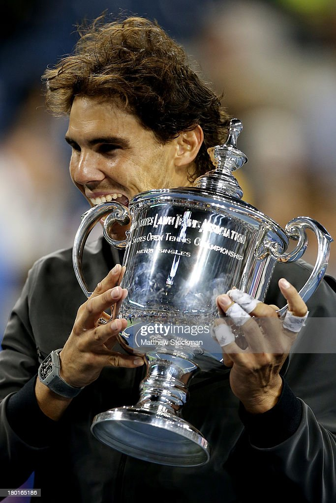 Rafael Nadal of Spain bites the US Open Championship trophy as he celebrates winning the men's singles final match against Novak Djokovic of Serbia on Day Fifteen of the 2013 US Open at the USTA Billie Jean King National Tennis Center on September 9, 2013 in the Flushing neighborhood of the Queens borough of New York City.