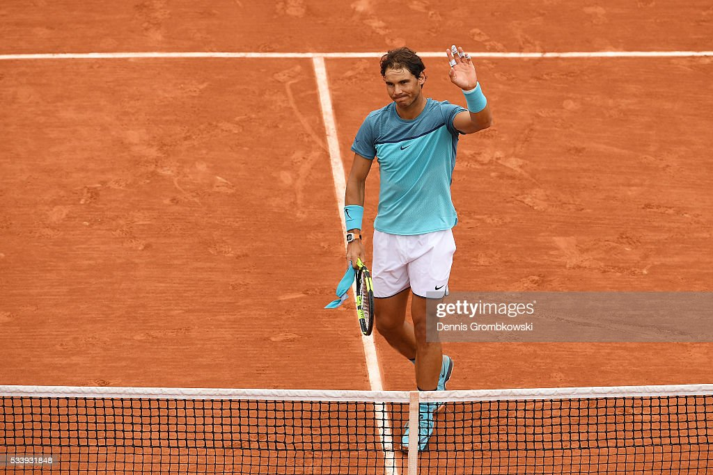 <a gi-track='captionPersonalityLinkClicked' href=/galleries/search?phrase=Rafael+Nadal&family=editorial&specificpeople=194996 ng-click='$event.stopPropagation()'>Rafael Nadal</a> of Spain celbrates following his victory during the Men's Singles first round match against Sam Groth of Australia on day three of the 2016 French Open at Roland Garros on May 24, 2016 in Paris, France.