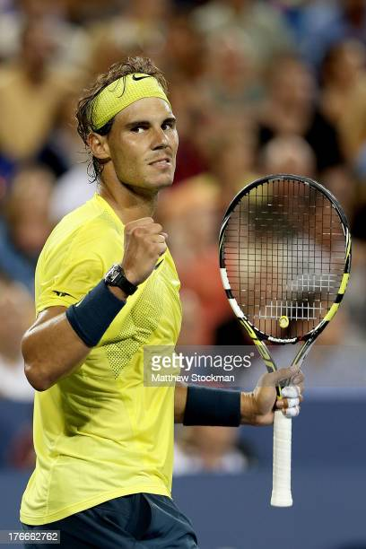 Rafael Nadal of Spain celebrate match point against Roger Federer of Switzerland during the Western Southern Open on August 16 2013 at Lindner Family...
