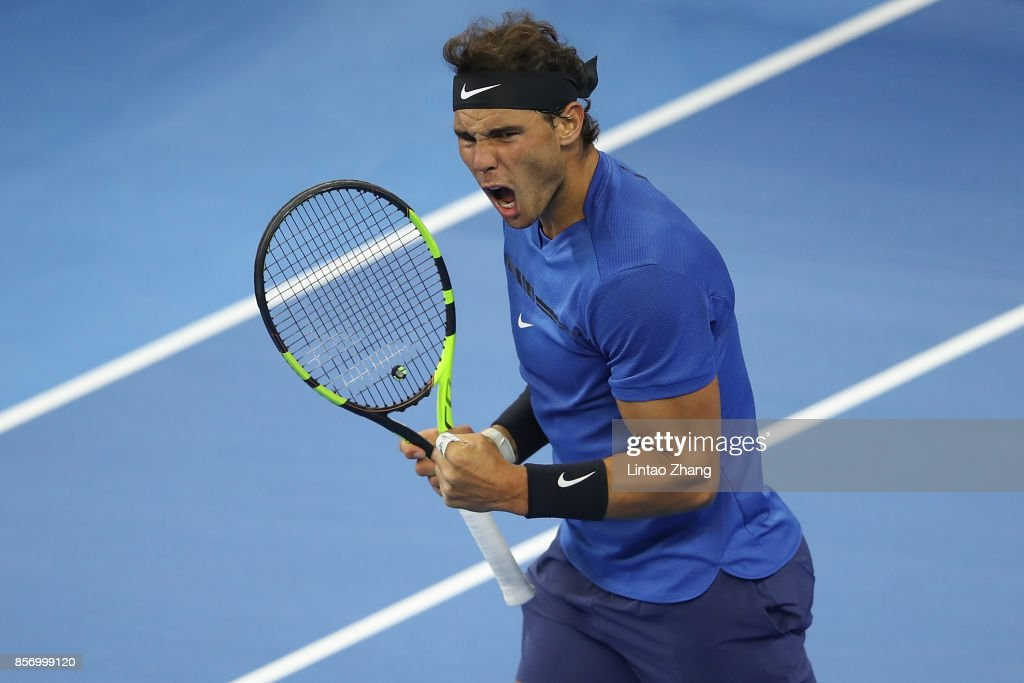Rafael Nadal of Spain celebrates a point against Lucas Pouille of France during the Men's singles first round on day four of 2017 China Open at the China National Tennis Centre on October 3, 2017 in Beijing, China.