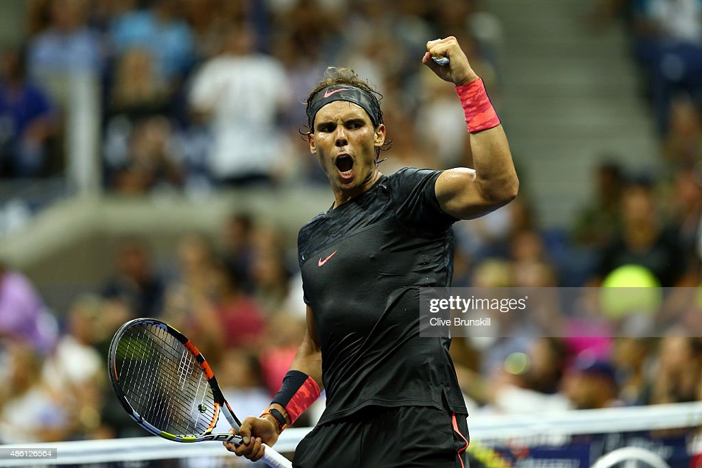 Rafael Nadal of Spain celebrates a point in the fourth set against Borna Coric of Croatia during their Men's Singles First Round match on Day One of...
