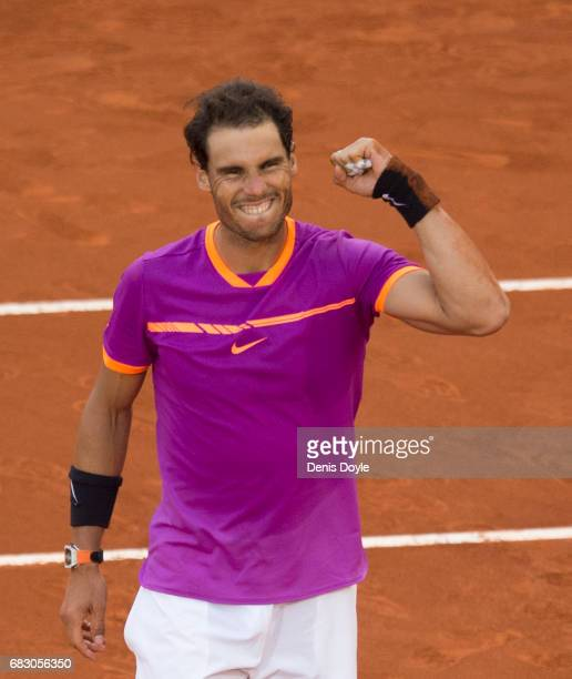 Rafael Nadal of Spain celebrates after beating Dominic Thiem of Austria in the men's final at La Caja Magica on May 14 2017 in Madrid Spain
