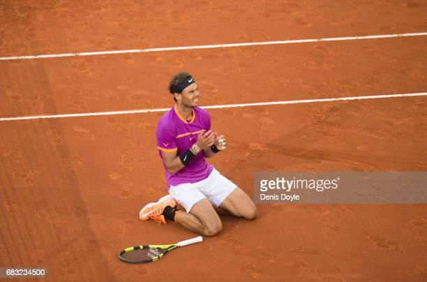 Rafael Nadal of Spain celebrates after beating Dominic Thiem of Austria in the men's final at La Caja Magica on May 14 2017 in Madrid Spain at La...