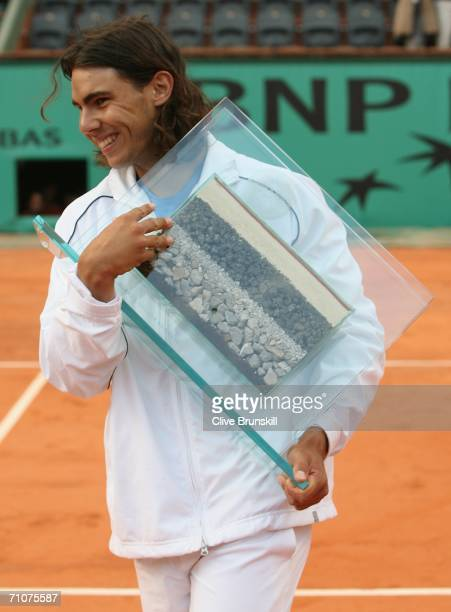 Rafael Nadal of Spain celebrates after breaking Guillermo Vilas' record of 53 consecutive clay court wins during day two of the French Open at Roland...