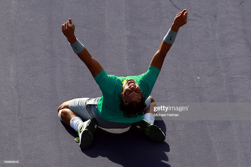 <a gi-track='captionPersonalityLinkClicked' href=/galleries/search?phrase=Rafael+Nadal&family=editorial&specificpeople=194996 ng-click='$event.stopPropagation()'>Rafael Nadal</a> of Spain celebrates after defeating Juan Martin Del Potro of Argentina during their men's final match of the 2013 BNP Paribas Open at the Indian Wells Tennis Garden on March 17, 2013 in Indian Wells, California.