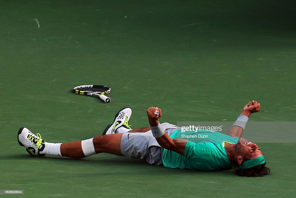 <a gi-track='captionPersonalityLinkClicked' href=/galleries/search?phrase=Rafael+Nadal&family=editorial&specificpeople=194996 ng-click='$event.stopPropagation()'>Rafael Nadal</a> of Spain celebrates after defeating Juan Martin Del Potro of Argentina to win the men's final match of the 2013 BNP Paribas Open at the Indian Wells Tennis Garden on March 17, 2013 in Indian Wells, California.