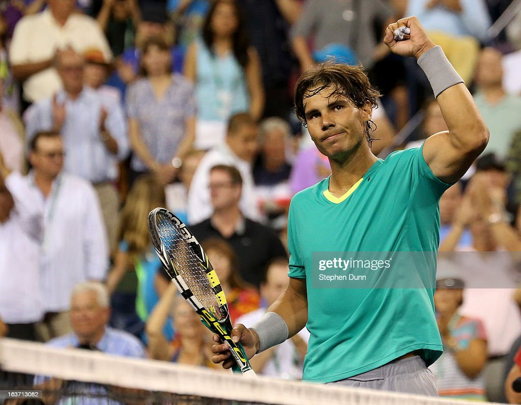 <a gi-track='captionPersonalityLinkClicked' href=/galleries/search?phrase=Rafael+Nadal&family=editorial&specificpeople=194996 ng-click='$event.stopPropagation()'>Rafael Nadal</a> of Spain celebrates after defeating Roger Federer of Switzerland in their quarterfinal match during day 9 of the BNP Paribas Open at Indian Wells Tennis Garden on March 14, 2013 in Indian Wells, California. Nadal won 6-4, 6-2.