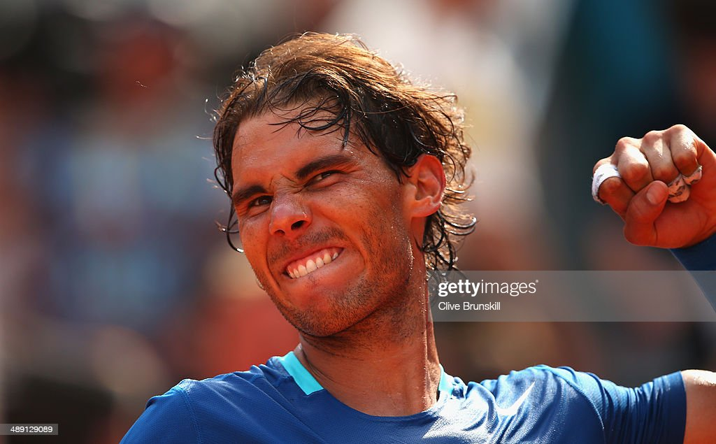 <a gi-track='captionPersonalityLinkClicked' href=/galleries/search?phrase=Rafael+Nadal&family=editorial&specificpeople=194996 ng-click='$event.stopPropagation()'>Rafael Nadal</a> of Spain celebrates after his straight sets victory against Roberto Bautista Agut of Spain in their semi final match during day eight of the Mutua Madrid Open tennis tournament at the Caja Magica on May 10, 2014 in Madrid, Spain.