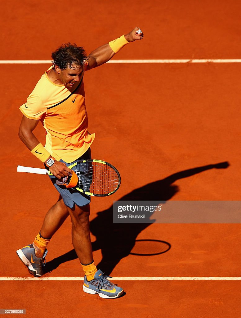 <a gi-track='captionPersonalityLinkClicked' href=/galleries/search?phrase=Rafael+Nadal&family=editorial&specificpeople=194996 ng-click='$event.stopPropagation()'>Rafael Nadal</a> of Spain celebrates after his straight sets victory against Andrey Kuznetsov of Russia in their second round match during day four of the Mutua Madrid Open tennis tournament at the Caja Magica on May 03, 2016 in Madrid,Spain.