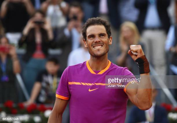 Rafael Nadal of Spain celebrates after winning at match point against Dominic Thiem of Austria in the final during day nine of the Mutua Madrid Open...