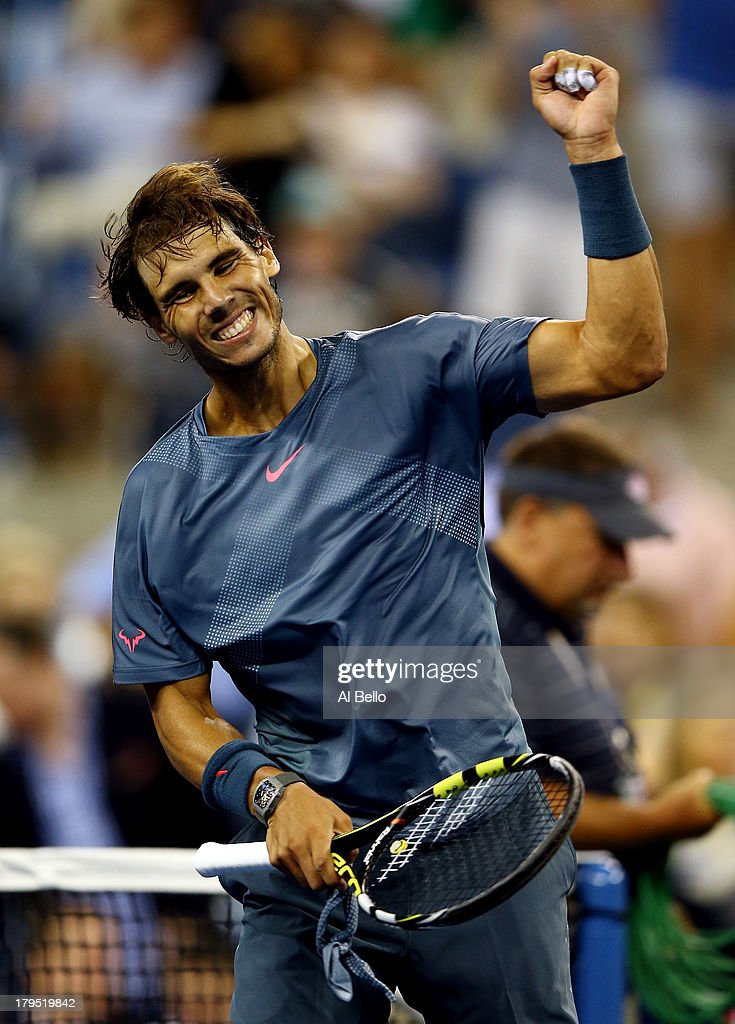 <a gi-track='captionPersonalityLinkClicked' href=/galleries/search?phrase=Rafael+Nadal&family=editorial&specificpeople=194996 ng-click='$event.stopPropagation()'>Rafael Nadal</a> of Spain celebrates after winning his men's singles quarter final match against Tommy Robredo of Spain on Day Ten of the 2013 US Open at USTA Billie Jean King National Tennis Center on September 4, 2013 in the Flushing neighborhood of the Queens borough of New York City.