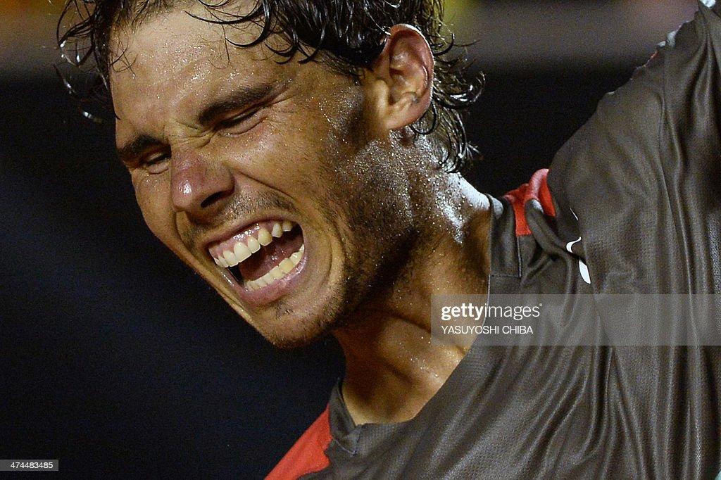 Rafael Nadal of Spain celebrates after winning the 2014 Rio Open men's singles final tennis match against Alexandr Dolgopolov of Ukraine in Rio de Janeiro, Brazil, on February 23, 2014. AFP PHOTO / YASUYOSHI CHIBA