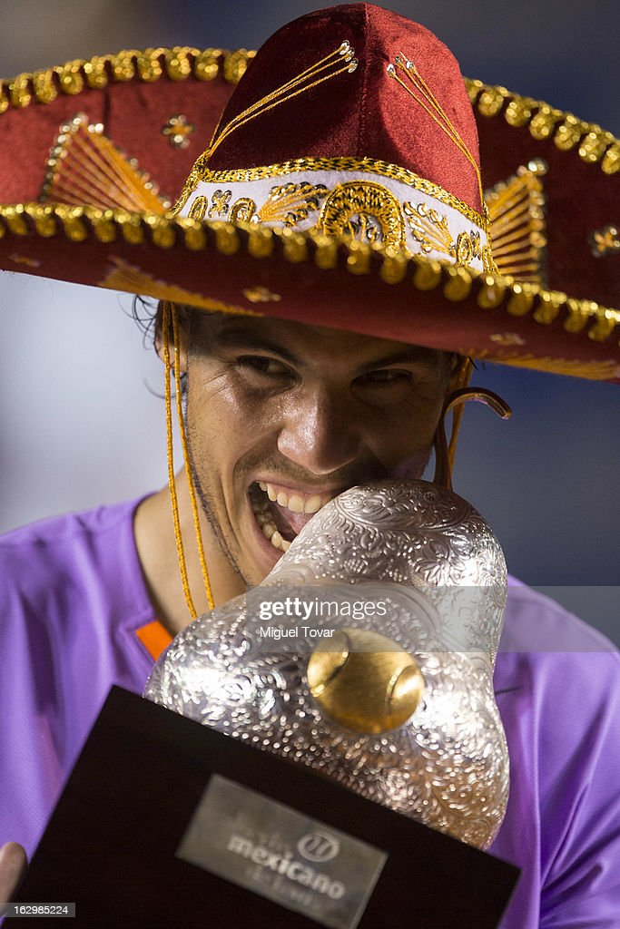 <a gi-track='captionPersonalityLinkClicked' href=/galleries/search?phrase=Rafael+Nadal&family=editorial&specificpeople=194996 ng-click='$event.stopPropagation()'>Rafael Nadal</a> of Spain celebrates after winning the final tennis match against David Ferrer of Spain as part of the Mexican Tennis Open Acapulco 2013 at Pacific resort on March 02, 2013 in Acapulco, Mexico.