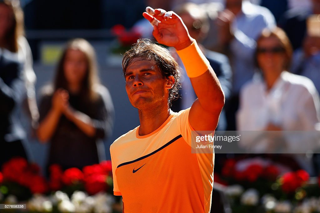 <a gi-track='captionPersonalityLinkClicked' href=/galleries/search?phrase=Rafael+Nadal&family=editorial&specificpeople=194996 ng-click='$event.stopPropagation()'>Rafael Nadal</a> of Spain celebrates defeating Andrey Kuznetsov of Russia during day four of the Mutua Madrid Open tennis tournament at the Caja Magica on May 03, 2016 in Madrid, Spain.