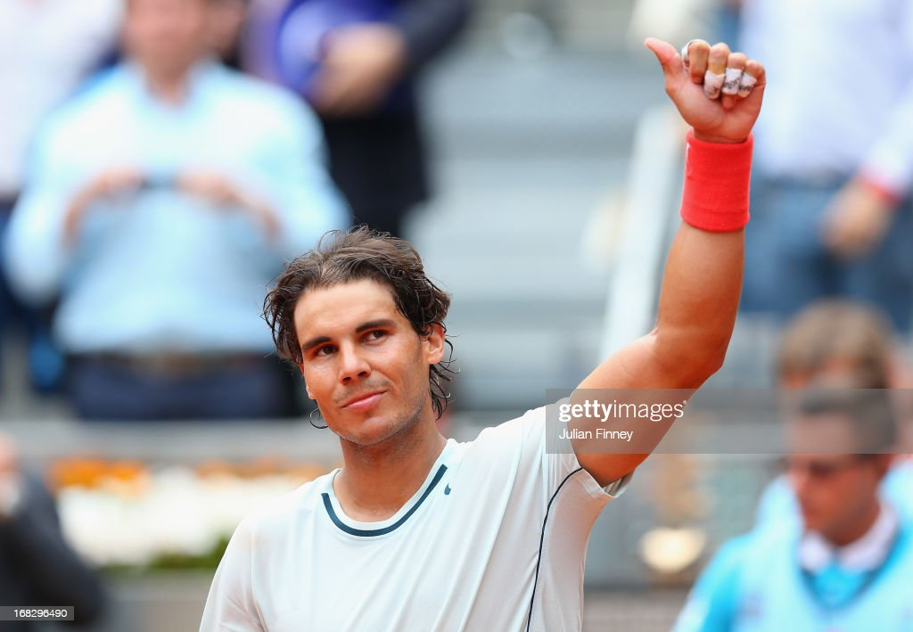 <a gi-track='captionPersonalityLinkClicked' href=/galleries/search?phrase=Rafael+Nadal&family=editorial&specificpeople=194996 ng-click='$event.stopPropagation()'>Rafael Nadal</a> of Spain celebrates defeating Benoit Paire of France during day five of the Mutua Madrid Open tennis tournament at the Caja Magica on May 8, 2013 in Madrid, Spain.