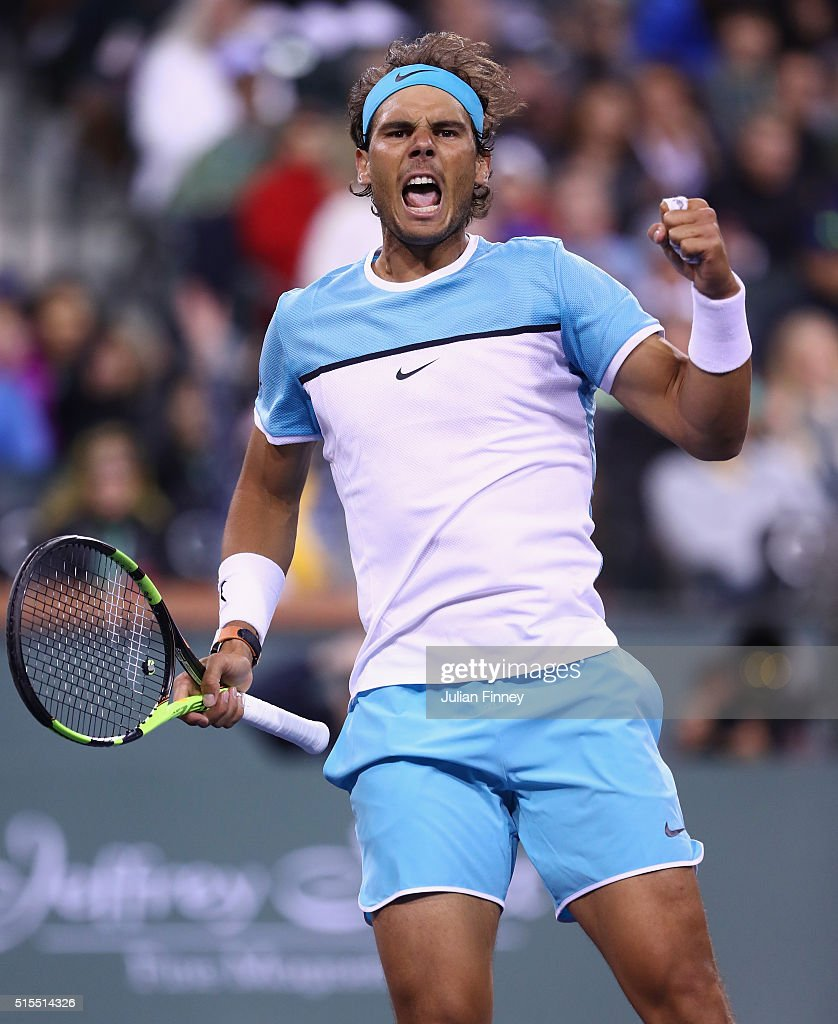 Rafael Nadal of Spain celebrates defeating Gilles Muller of Luxembourg during day seven of the BNP Paribas Open at Indian Wells Tennis Garden on...