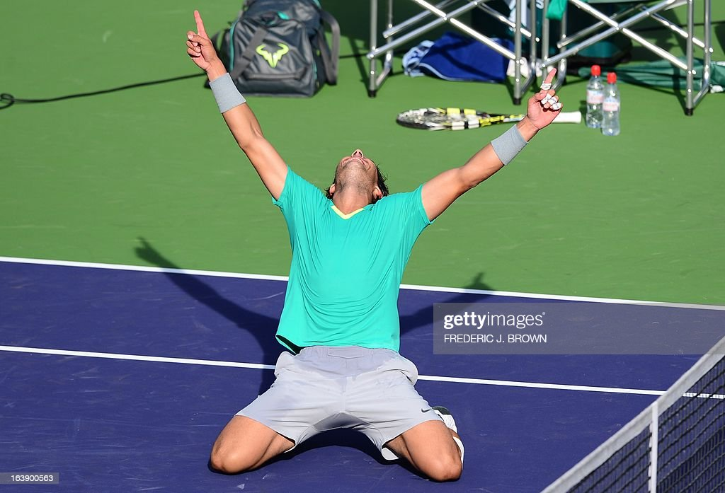 Rafael Nadal of Spain celebrates defeating Juan Martin Del Potro of Argentina 4-6, 6-3, 6-4 in the men's BNP Paribas Open final on March 17, 2013 in Indian Wells, California. AFP PHOTO/Frederic J. BROWN