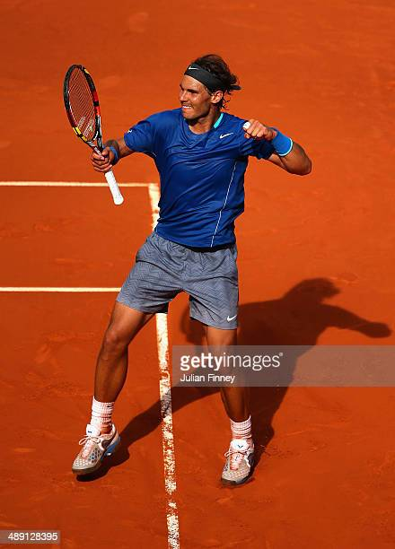 Rafael Nadal of Spain celebrates defeating Roberto Bautista Agut of Spain during day eight of the Mutua Madrid Open tennis tournament at the Caja...