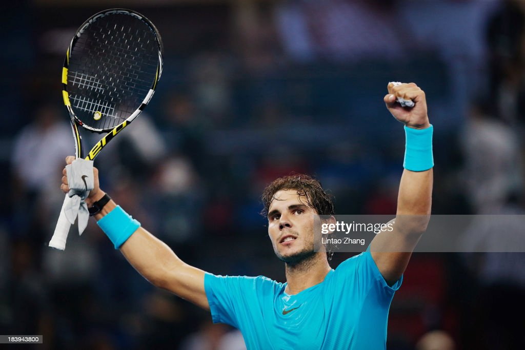 <a gi-track='captionPersonalityLinkClicked' href=/galleries/search?phrase=Rafael+Nadal&family=editorial&specificpeople=194996 ng-click='$event.stopPropagation()'>Rafael Nadal</a> of Spain celebrates his win against Carlos Berlocq of Argentina during the Shanghai Rolex Masters at the Qi Zhong Tennis Center on October 10, 2013 in Shanghai, China.