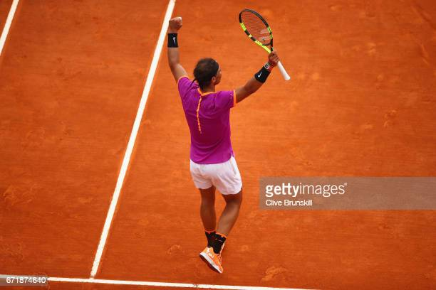 Rafael Nadal of Spain celebrates match point after his straight set victory against Albert RamosVinolas of Spain in the final on day eight of the...