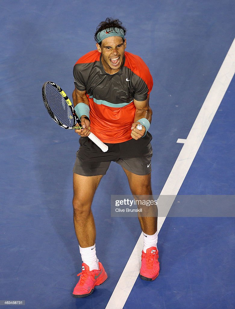 <a gi-track='captionPersonalityLinkClicked' href=/galleries/search?phrase=Rafael+Nadal&family=editorial&specificpeople=194996 ng-click='$event.stopPropagation()'>Rafael Nadal</a> of Spain celebrates match point after his straight sets victory in his third round match against Gael Monfils of France during day six of the 2014 Australian Open at Melbourne Park on January 18, 2014 in Melbourne, Australia.