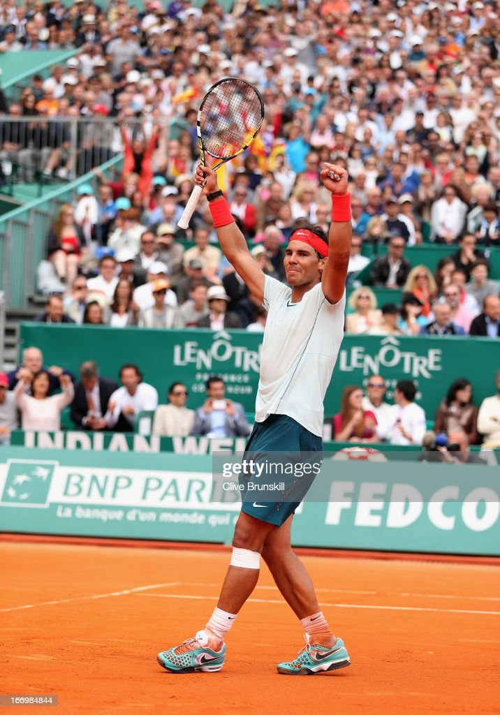 <a gi-track='captionPersonalityLinkClicked' href=/galleries/search?phrase=Rafael+Nadal&family=editorial&specificpeople=194996 ng-click='$event.stopPropagation()'>Rafael Nadal</a> of Spain celebrates match point against Grigor Dimitrov of Bulgaria in their quarter final match during day six of the ATP Monte Carlo Masters, at Monte-Carlo Sporting Club on April 19, 2013 in Monte-Carlo, Monaco.