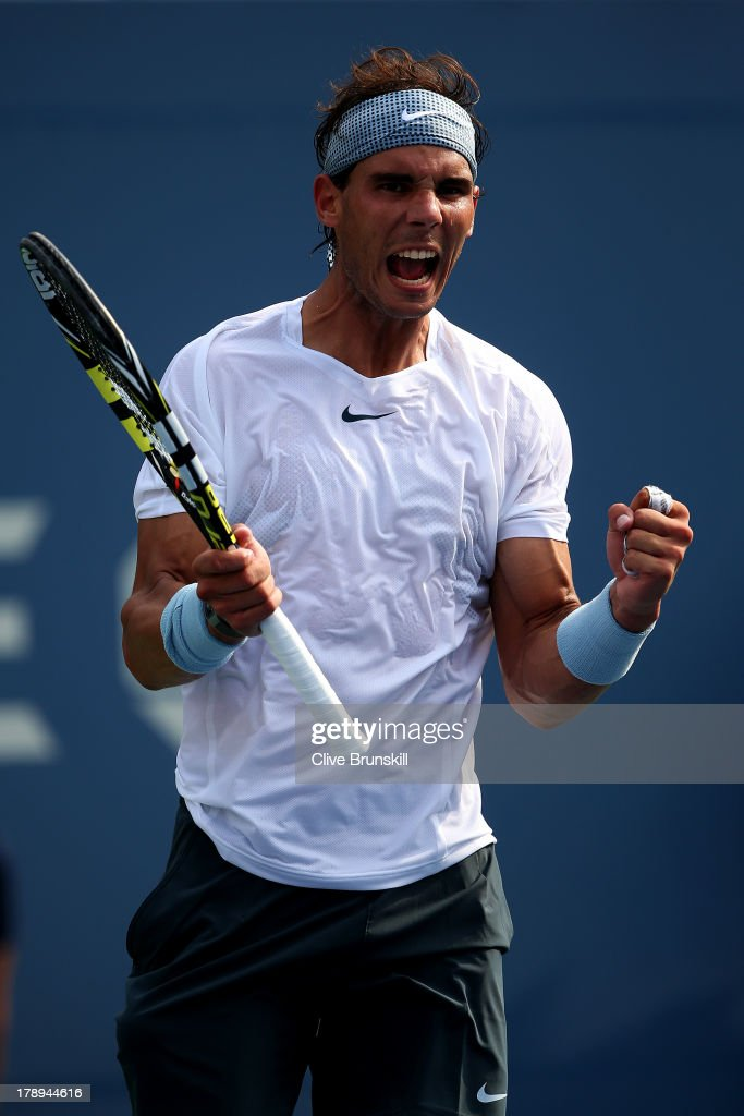 <a gi-track='captionPersonalityLinkClicked' href=/galleries/search?phrase=Rafael+Nadal&family=editorial&specificpeople=194996 ng-click='$event.stopPropagation()'>Rafael Nadal</a> of Spain celebrates match point during his men's singles third round match against Ivan Dodig of Croatia on Day Six of the 2013 US Open at USTA Billie Jean King National Tennis Center on August 31, 2013 in the Flushing neighborhood of the Queens borough of New York City.