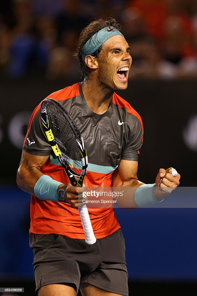 <a gi-track='captionPersonalityLinkClicked' href=/galleries/search?phrase=Rafael+Nadal&family=editorial&specificpeople=194996 ng-click='$event.stopPropagation()'>Rafael Nadal</a> of Spain celebrates match point in his third round match against Gael Monfils of France during day six of the 2014 Australian Open at Melbourne Park on January 18, 2014 in Melbourne, Australia.