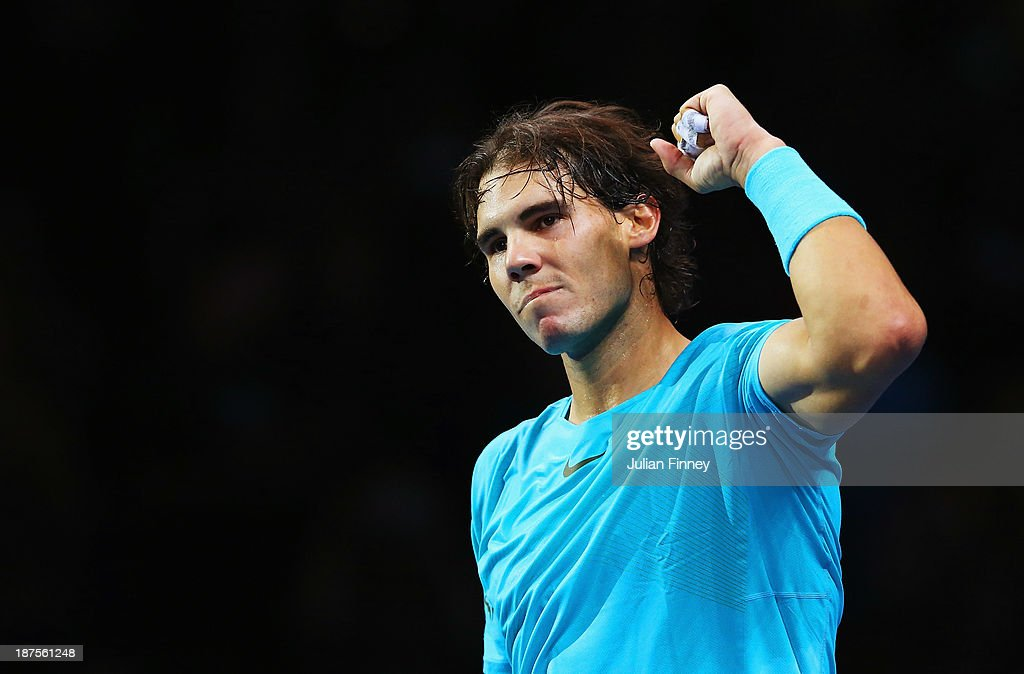 <a gi-track='captionPersonalityLinkClicked' href=/galleries/search?phrase=Rafael+Nadal&family=editorial&specificpeople=194996 ng-click='$event.stopPropagation()'>Rafael Nadal</a> of Spain celebrates victory after his men's singles semi-final match against Roger Federer of Switzerland during day seven of the Barclays ATP World Tour Finals at O2 Arena on November 10, 2013 in London, England.