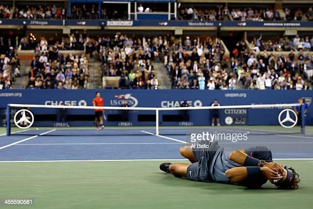 Rafael Nadal of Spain celebrates victory as Novak Djokovic of Serbia walks back to his chair after their men's singles final match against Novak...