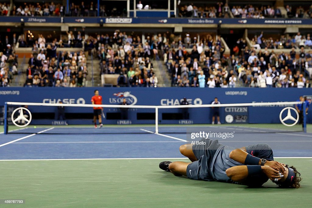 <a gi-track='captionPersonalityLinkClicked' href=/galleries/search?phrase=Rafael+Nadal&family=editorial&specificpeople=194996 ng-click='$event.stopPropagation()'>Rafael Nadal</a> of Spain celebrates victory as <a gi-track='captionPersonalityLinkClicked' href=/galleries/search?phrase=Novak+Djokovic&family=editorial&specificpeople=588315 ng-click='$event.stopPropagation()'>Novak Djokovic</a> of Serbia walks back to his chair after their men's singles final match against <a gi-track='captionPersonalityLinkClicked' href=/galleries/search?phrase=Novak+Djokovic&family=editorial&specificpeople=588315 ng-click='$event.stopPropagation()'>Novak Djokovic</a> of Serbia on Day Fifteen of the 2013 US Open at the USTA Billie Jean King National Tennis Center on September 9, 2013 in the Flushing neighborhood of the Queens borough of New York City.