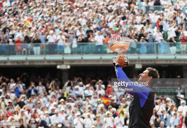Rafael Nadal of Spain celebrates victory during his Men's Singles Final match against Stan Wawrinka of Switzerland on day fifthteen at Roland Garros...