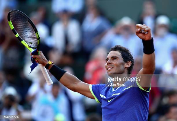 Rafael Nadal of Spain celebrates victory following the mens singles semifinal match against Dominic Thiem of Austria on day thirteen of the 2017...