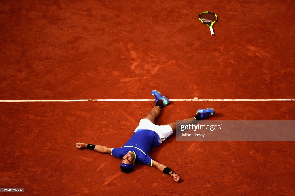Rafael Nadal of Spain celebrates victory following the mens singles final against Stan Wawrinka of Switzerland on day fifteen of the 2017 French Open at Roland Garros on June 11, 2017 in Paris, France.