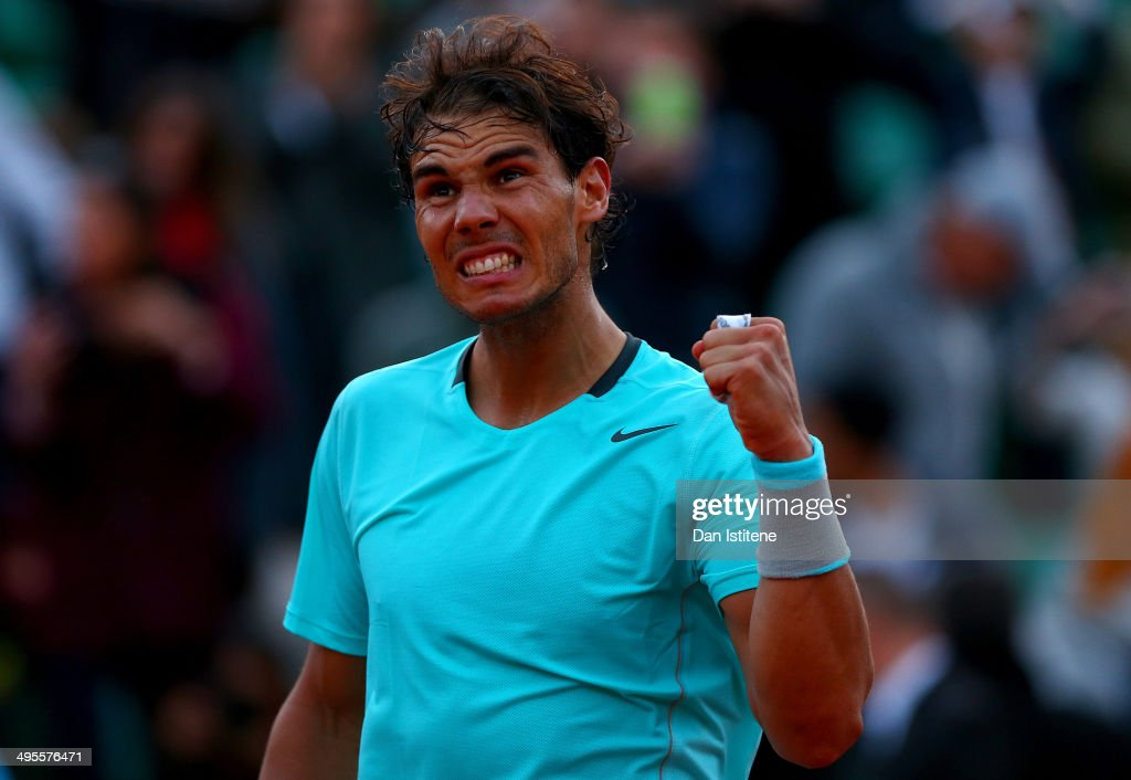 Rafael Nadal of Spain celebrates victory in his men's singles quarter-final match against David Ferrer of Spain on day eleven of the French Open at Roland Garros on June 4, 2014 in Paris, France.