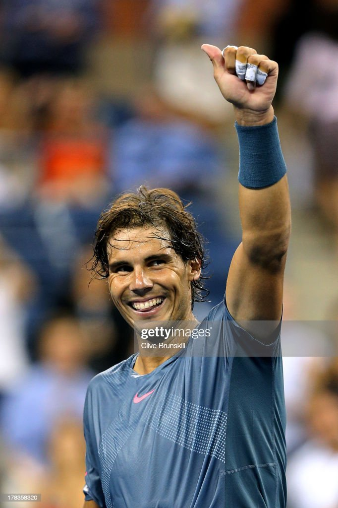 <a gi-track='captionPersonalityLinkClicked' href=/galleries/search?phrase=Rafael+Nadal&family=editorial&specificpeople=194996 ng-click='$event.stopPropagation()'>Rafael Nadal</a> of Spain celebrates victory in his men's singles second round match against Rogerio Dutra Silva of Brazil on Day Four of the 2013 US Open at USTA Billie Jean King National Tennis Center on August 29, 2013 in the Flushing neighborhood of the Queens borough of New York City.