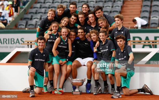Rafael Nadal of Spain celebrates victory with the ball boys and girls following the mens singles final against Stan Wawrinka of Switzerland on day...