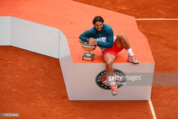 Rafael Nadal of Spain celebrates victory with the Coupe des Mousquetaires trophy in the men's singles final against David Ferrer of Spain during day...